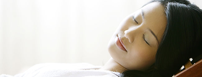Alleviate Dental Anxiety with Sedation Dentistry - Sedated Woman